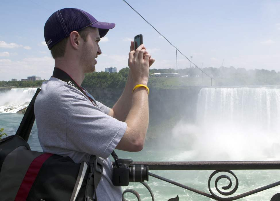 Jason Nutter of Seattle, WA photographs the tightrope that Nik Wallenda will use to walk over Niagara Falls in Niagara Falls, Ont., on Friday, June 15, 2012.  (Frank Gunn / THE CANADIAN PRESS)