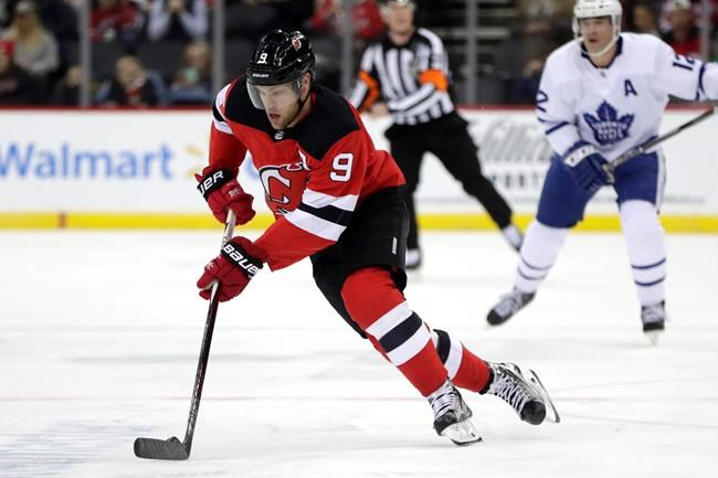 New Jersey Devils left wing Taylor Hall skates with the puck against the Toronto Maple Leafs during the second period of an NHL hockey game, Tuesday, Dec. 18, 2018, in Newark, N.J. (AP Photo/Julio Cortez)