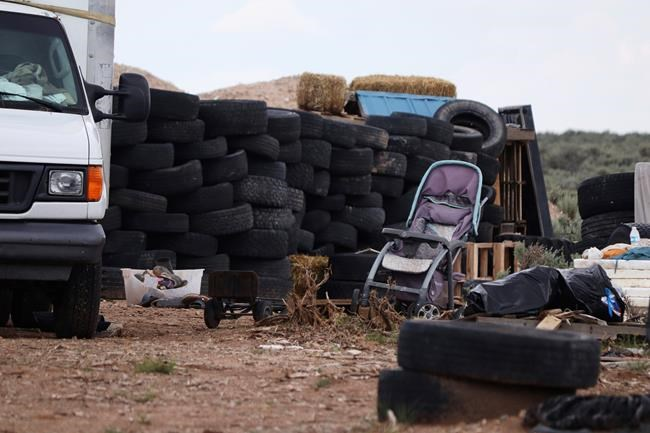 This Aug. 5, 2018 photo shows debris outside the location where people camped near Amalia, N.M. Three women believed to be the mothers of 11 children found hungry and living in a filthy makeshift compound in rural northern New Mexico have been arrested, following the weekend arrests of two men, authorities said Monday, Aug. 6. (Jesse Moya/Santa Fe New Mexican via AP)