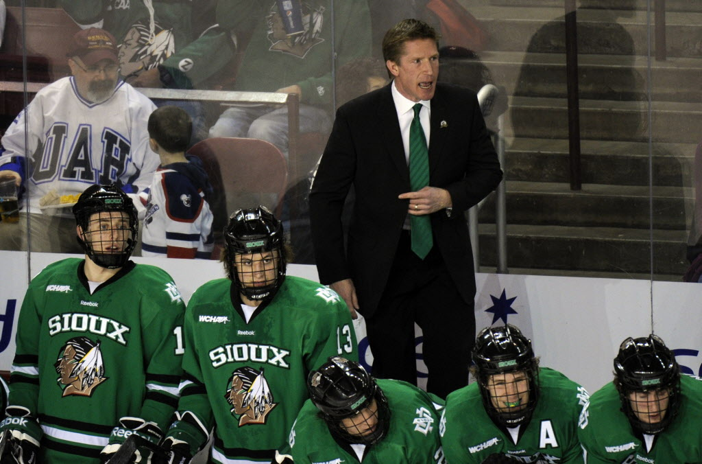 North Dakota head coach Dave Hakstol, top, coaches his team in this file photo.