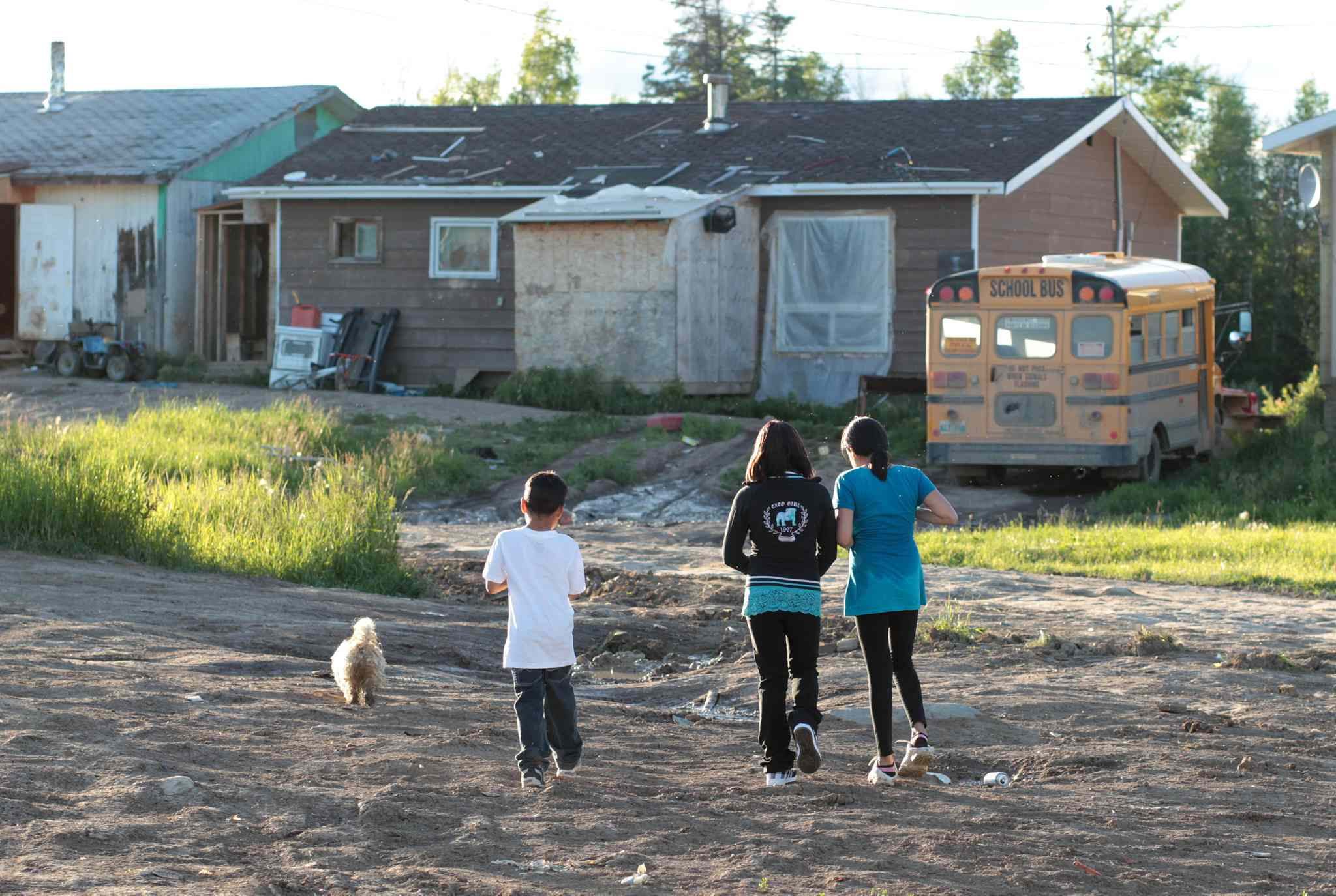 Children walk down a road in Red Sucker Lake First Nation in July 2010.