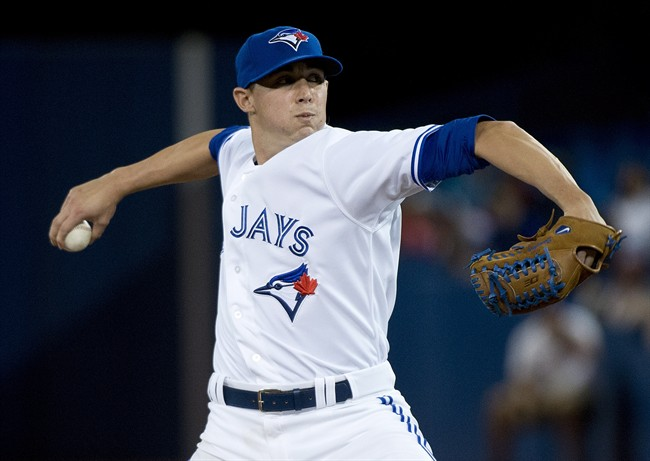 Toronto Blue Jays pitcher Aaron Sanchez makes his major league debut as he pitches against the Boston Red Sox during seventh inning AL baseball action in Toronto on Wednesday, July 23, 2014. THE CANADIAN PRESS/Nathan Denette