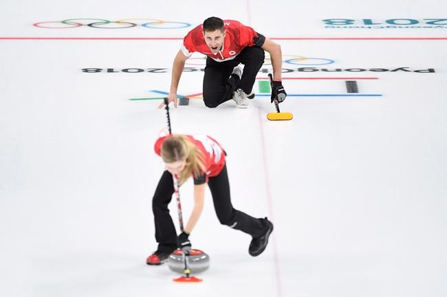 Canada's Kaitlyn Lawes and teammate John Morris play their stone during mixed doubles gold-medal curling action against Switzerland at the Olympic Winter Games in Gangneung, South Korea on Tuesday, February 13, 2018. THE CANADIAN PRESS/Nathan Denette