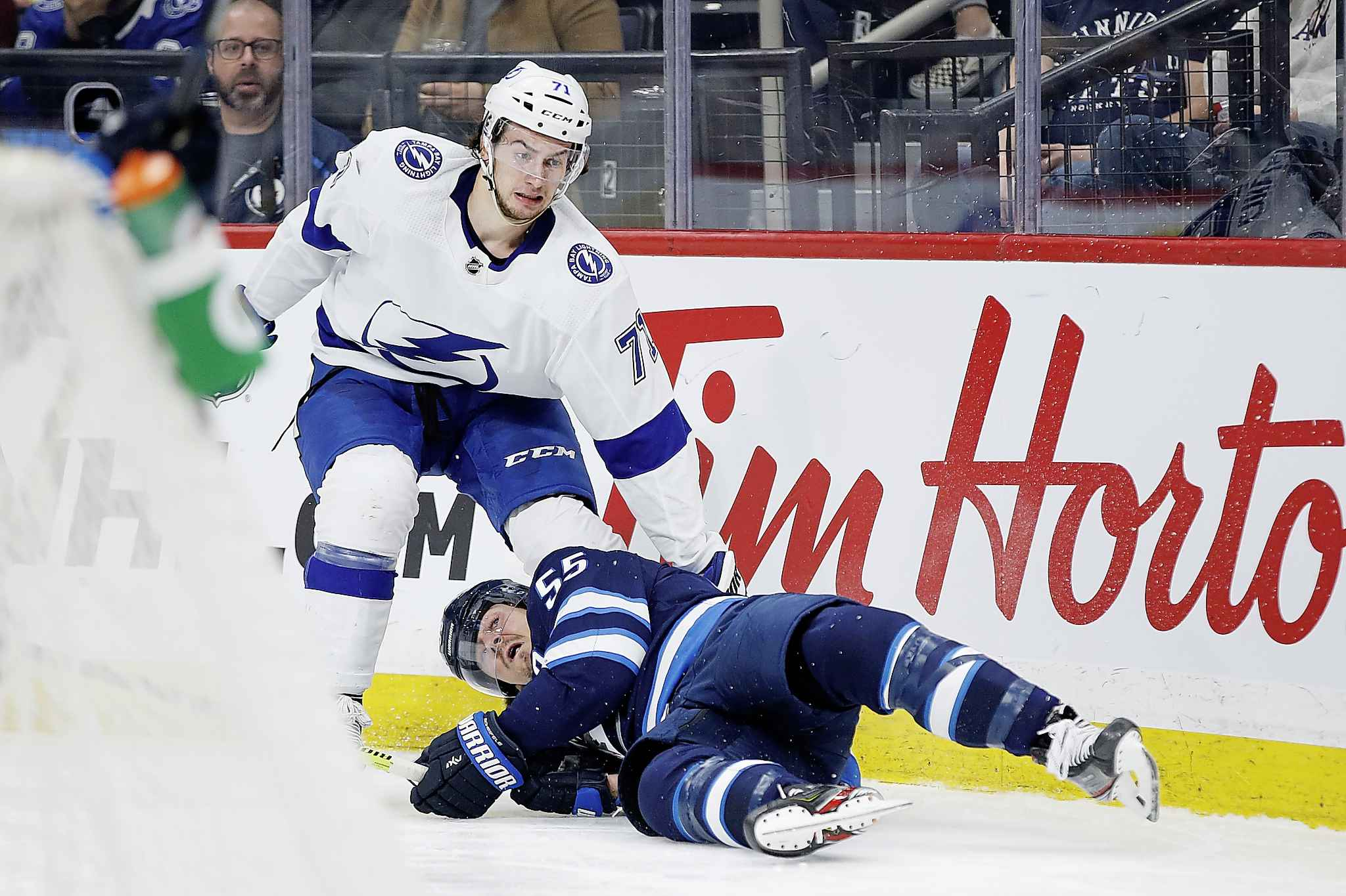 <p>Winnipeg Jets' Mark Scheifele gets checked by Tampa Bay Lightning's Anthony Cirelli during second period NHL action in Winnipeg on Friday.</p>