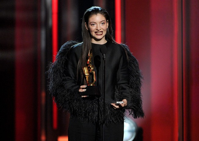 Lorde accepts the award for top new artist at the Billboard Music Awards at the MGM Grand Garden Arena on Sunday, May 18, 2014, in Las Vegas. (Photo by Chris Pizzello/Invision/AP)