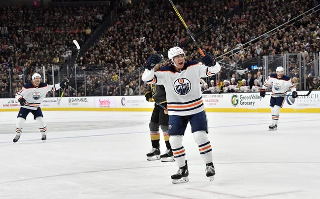 Edmonton Oilers defenseman Ethan Bear celebrates after scoring against the Vegas Golden Knights during the first period of an NHL hockey game Saturday, Nov. 23, 2019, in Las Vegas. (AP Photo/David Becker)