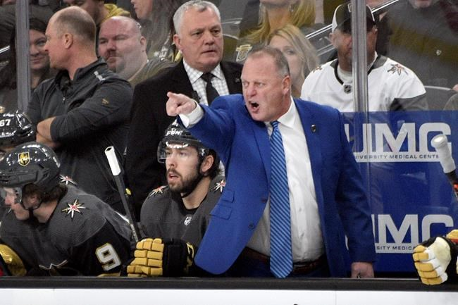 Vegas Golden Knights coach Gerard Gallant questions a call during the first period of the team's NHL hockey game against the Arizona Coyotes on Saturday, Dec. 28, 2019, in Las Vegas. (AP Photo/David Becker)