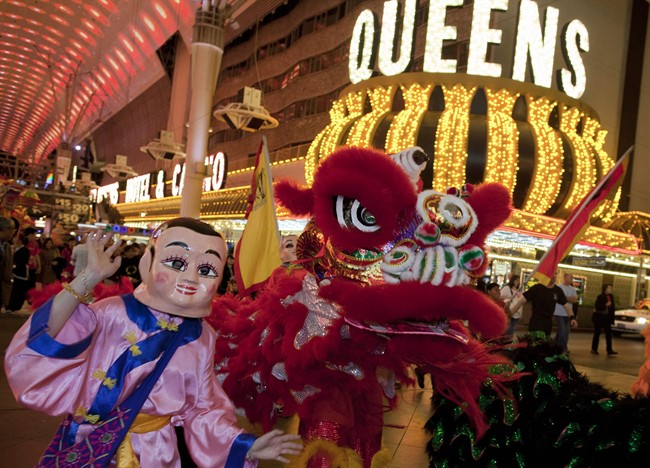Members of the Lohan School of Shaolin parade up and down Fremont Street while doing a dragon and lion dance during Chinese New Years festivities, Wednesday, Jan. 25, 2012, in Las Vegas. There are generally more Asian gamblers in Vegas because of the Chinese New Year, and it means increased traffic at high limit baccarat tables. Though not widely known, baccarat is actually the most profitable table game for casinos which try to court Asian gamblers who tie luck and good fortune to the start of the Lunar Year. (AP Photo/Julie Jacobson)