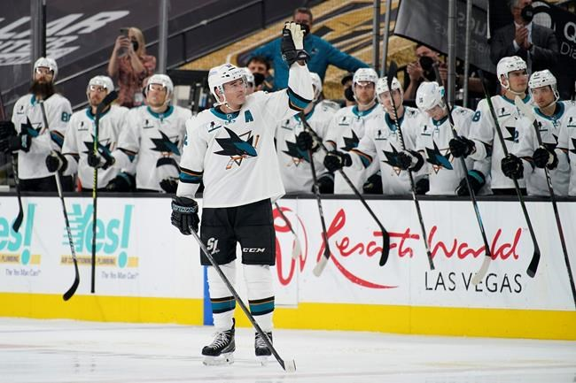San Jose Sharks center Patrick Marleau (12) waves to the crowd during a small ceremony to mark his passing Gordie Howe for most NHL games played in the first period of an NHL hockey game Monday, April 19, 2021, in Las Vegas. (AP Photo/John Locher)