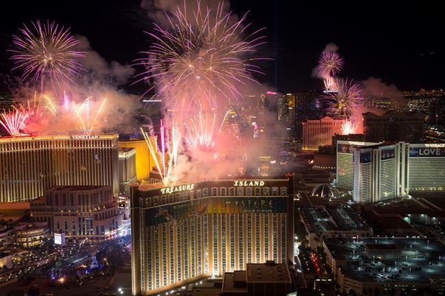 New Year's fireworks are seen along the Strip from the top of the Trump International, Monday, Jan. 1, 2018. (Richard Brian/Las Vegas Review-Journal via AP)