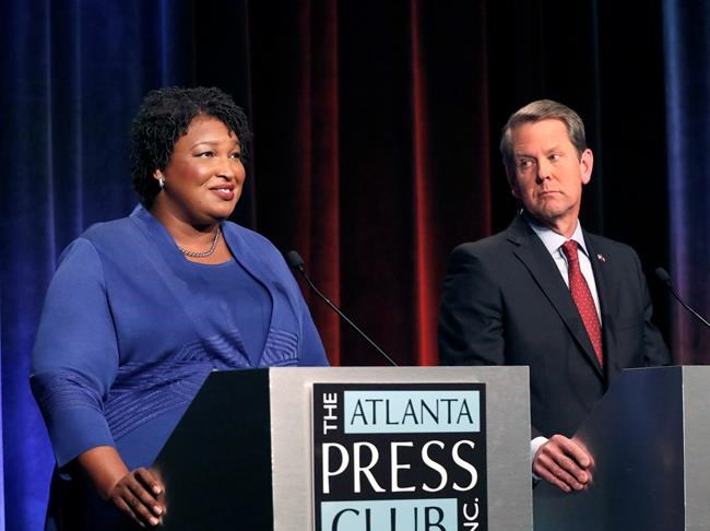 Democratic gubernatorial candidate for Georgia Stacey Abrams (left) speaks as her Republican opponent Secretary of State Brian Kemp looks on during a debate in Atlanta. (John Bazemore / The Associated Press)