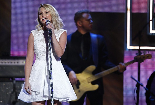 """FILE - In this Dec. 2, 2014 file photo, Miranda Lambert performs during the CMT Artist of the Year Awards at the Schermerhorn Symphony Center in Nashville, Tenn. The ACMs announced Friday, Jan. 30, 2015, that Lambert is the top contender, including a nomination for entertainer of the year, pitting her against top-billing male stars Garth Brooks, Luke Bryan, Jason Aldean and Florida Georgia Line. Lambert is also nominated for album of the year for """"Platinum"""" and female vocalist of the year. (Photo by Wade Payne/Invision/AP)"""