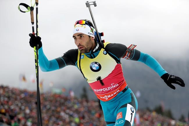 FILE - In this Sunday, Jan. 14, 2018 file photo, second placed Martin Fourcade of France leaves the shooting range during the men's 15km mass start competition at the biathlon World Cup in Ruhpolding, Germany. The 29-year-old Fourcade has been the sport's most dominant competitor since the 2011-12 season when he won the first of six straight World Cup total score championships. He's considered a favorite to take home gold in South Korea. (AP Photo/Matthias Schrader, File)