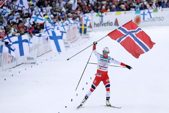 FILE - In this March 2, 2017, file photo, Norway's MaritBjoergen arrives at the finish area to win the women's cross country 4x5 km relay classic free competition with her teammates Astrid Uhrenholdt Jacobsen, HeidiWeng and Maiken Caspersen Falla at the 2017 Nordic Skiing World Championships in Lahti, Finland. Bjoergen has won three gold medals in each of the last two Winter Games and looks for more next month in South Korea. (AP Photo/Matthias Schrader, File)
