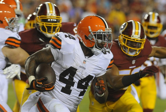 FILE - In this Aug. 18, 2014, file photo, Cleveland Browns running back Ben Tate (44) runs from Washington Redskins defensive end Jarvis Jenkins (99) and linebacker Keenan Robinson (52) during the first half of an NFL preseason football game in Landover, Md. Tate has returned to practice after missing Cleveland's past two games with a sprained right knee. Wearing a brace, Tate was on the practice field Tuesday, Sept. 30, 2014, for the first time since Sept. 5 as the Browns returned from their bye week. (AP Photo/Richard Lipski, File)