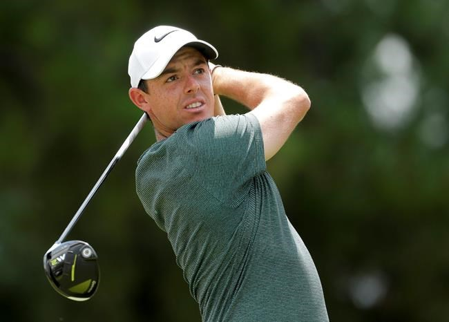 FILE - In this Aug. 12, 2017, file photo, Rory McIlroy watches his tee shot on the third hole during the third round of the PGA Championship golf tournament at the Quail Hollow Club in Charlotte, N.C. McIlroy says he has a heart ailment that will have to be monitored regularly but is not expected to affect his play. McIlroy said that he has a thickening of the left ventricle. He says doctors told him it was caused by a viral infection he suffered in China 18 months ago. He says he'll get an electrocardiogram every six months and an MRI once per year. (AP Photo/Chuck Burton, File)