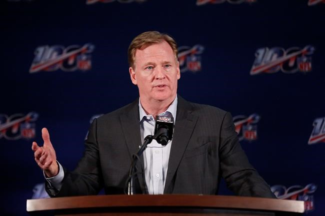 FILE - In this May 22, 2019, file photo, NFL Commissioner Roger Goodell speaks to the media during the NFL football owners meeting in Key Biscayne, Fla. Goodell won't be sharing hugs with Joe Burrow or Chase Young or any of the other 32 first-rounders in the 2020 NFL Draft. He will offer congratulations remotely but otherwise this will be the barest of drafts. (AP Photo/Brynn Anderson, File)