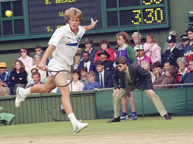 FILE - In this July 3, 1988, file photo, Sweden's Stefan Edberg reaches to return to Boris Becker during the men's singles final at Wimbledon. The game was delayed, started and abandoned for the night because of heavy rain. (AP Photo/Bob Dear, File)