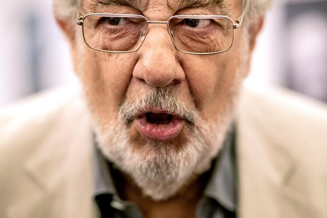 """In this Friday, July 12, 2019, photo, Placido Domingo speaks during a news conference about his upcoming show """"Giovanna d'Arco"""" in Madrid, Spain. Eight opera singers and a dancer have told The Associated Press that they were sexually harassed by Domingo, one of the most celebrated and powerful men in opera. The women say the encounters took place over three decades, at venues that included opera companies where he held top managerial positions. (AP Photo/Bernat Armangue)"""
