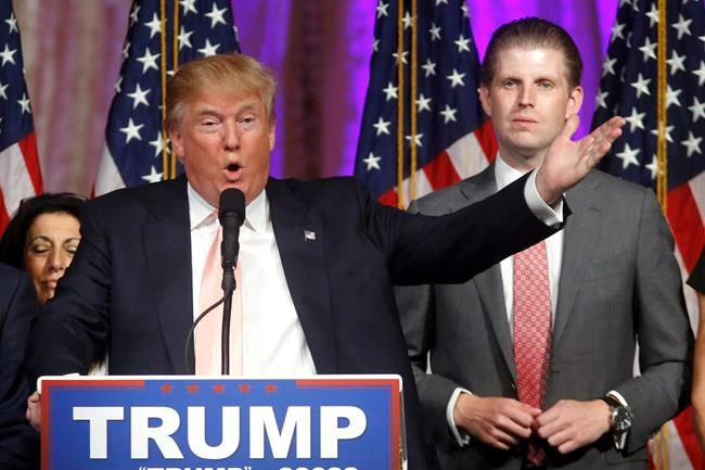 FILE - In this Tuesday, March 15, 2016 file photo, Republican presidential candidate Donald Trump speaks to supporters at his primary election night event at his Mar-a-Lago Club in Palm Beach, Fla. At right is his son Eric Trump. New York City is looking to terminate its contracts with Trump to run two Central Park skating rinks and other facilities after a Trump-inspired mob rioted and breached the U.S. Capitol, Mayor Bill de Blasio said Tuesday, Jan. 12, 2021. (AP Photo/Gerald Herbert)
