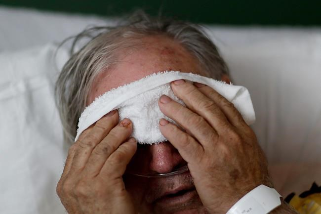 Flu, cold and coronavirus often share certain symptoms, but differences in intensity and how they appear can offer clues to which one is causing the misery.  (AP Photo/David Goldman)
