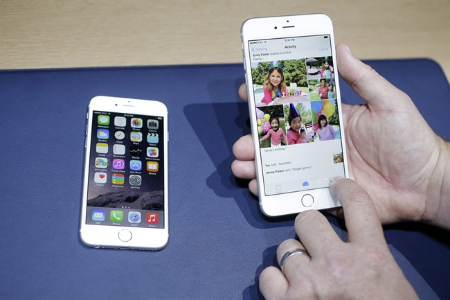 The iPhone 6, at left, and iPhone 6 plus are shown next to each other during a new product release in Cupertino, Calif. on Sept. 9, 2014. THE CANADIAN PRESS/AP, Marcio Jose Sanchez