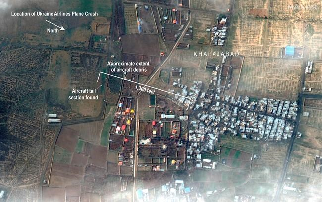 This satellite photo provided by Maxar Technologies on Thursday, Jan. 9, 2020, shows the site where a Ukrainian jetliner crashed late Tuesday near the town of Shahedshahr, Iran, southwest of the capital Tehran. The AP has annotated the image to show the location and length of the debris field. A separate version of this image without annotations has also moved. (Satellite image ©2020 Maxar Technologies via AP)