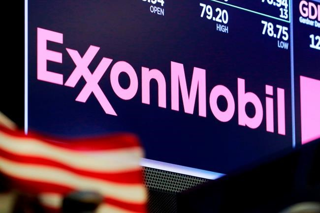 FILE - In this April 23, 2018, file photo, the logo for ExxonMobil appears above a trading post on the floor of the New York Stock Exchange. Exxon lost $1.1 billion in the second quarter, Friday, July 31, 2020, its economic pain deepening as the pandemic kept households on lockdown, diminishing the need for oil around the world. (AP Photo/Richard Drew, File)