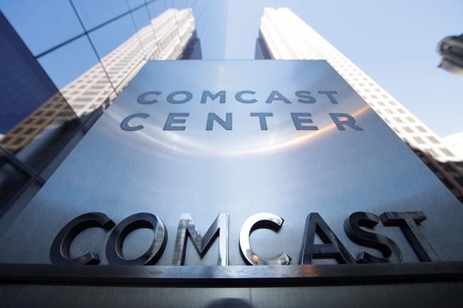 FILE - This March 29, 2017, file photo shows a sign outside the Comcast Center in Philadelphia. Comcast made a $65 billion bid Wednesday for Fox's entertainment businesses, setting up a battle with Disney to become the next mega-media company. (AP Photo/Matt Rourke, File)