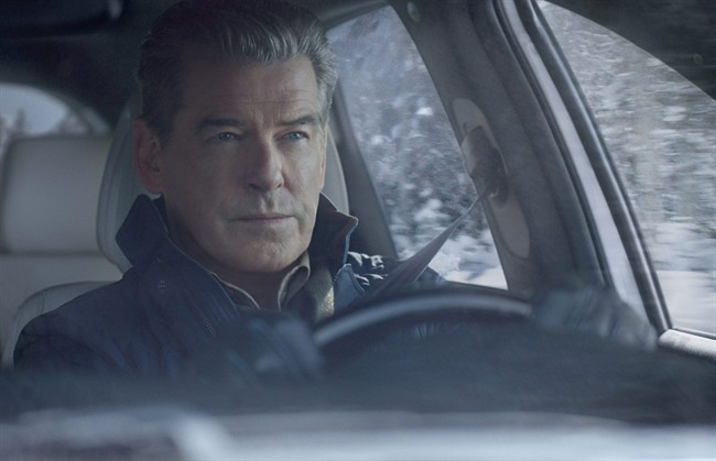 This image provided by Kia shows a portion of the company's television ad featuring Pierce Brosnan, scheduled to run during Super Bowl XLIX on Sunday, Feb. 1, 2015. (AP Photo/Kia)