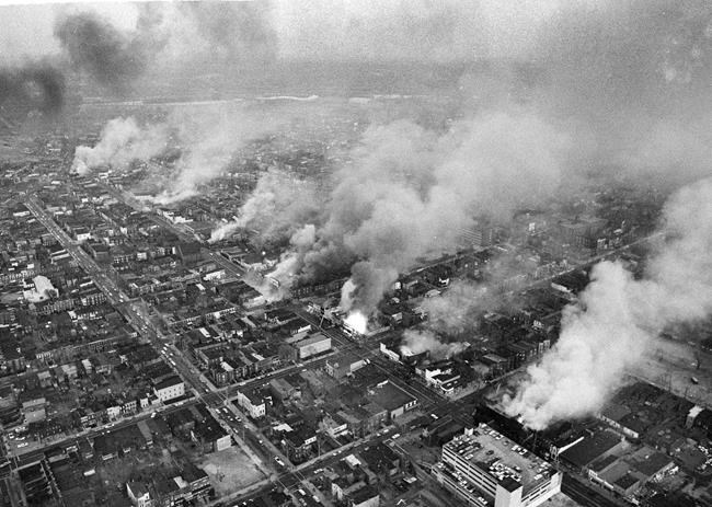 FILE - In this April 5, 1968 file photo, buildings burn along H Street in the northeast section of Washington, set afire during a day of demonstrations and rioting in reaction to the assassination of Dr. Martin Luther King Jr. (AP Photo/Charles Gorry, File)