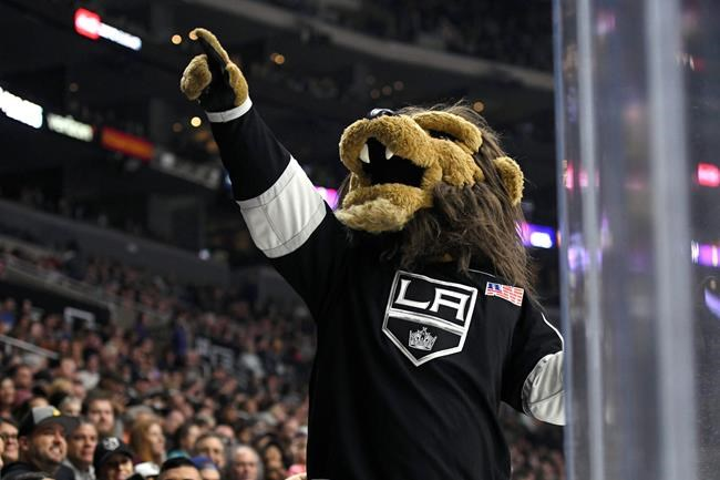 FILE - In this Sept. 30, 2017, file photo, Los Angeles Kings mascot Bailey entertains the crowd during a preseason NHL hockey game against the Anaheim Ducks in Los Angeles. The Los Angeles Kings have fired the employee who dresses as the hockey team's mascot after an investigation into a sexual harassment lawsuit filed against him earlier this year. (AP Photo/Michael Owen Baker, File)