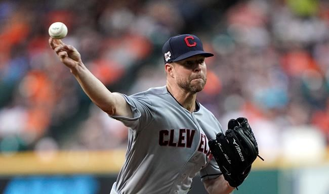FILE - In this April 26, 2019, file photo, Cleveland Indians starting pitcher Corey Kluber throws against the Houston Astros during the first inning of a baseball game in Houston. Texas traded for two-time AL Cy Young winner Corey Kluber this offseason after veteran free agent right-handers Jordan Lyles and Kyle Gibson had already signed to join the rotation. (AP Photo/David J. Phillip, File)