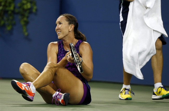 Jelena Jankovic, of Serbia, sits on the court after slipping during her match against Belinda Bencic, of Switzerland, in the fourth round of the 2014 U.S. Open tennis tournament, Sunday, Aug. 31, 2014, in New York. (AP Photo/Elise Amendola)
