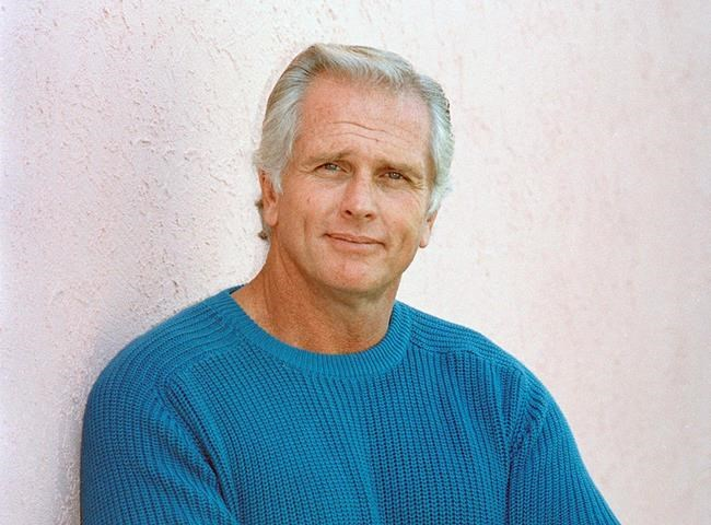 """FILE - This Dec. 28, 1987 file photo shows former """"Tarzan"""" actor Ron Ely during an interview in Los Angeles. A woman was killed at Ely's Southern California home and sheriff's deputies fatally shot a suspect on the property, authorities said Wednesday, Oct. 16, 2019. A Santa Barbara County sheriff's office statement does not identify any of those involved but notes that a disabled elderly man living at the home was taken to a hospital for evaluation. The deaths occurred Tuesday night in Hope Ranch, a suburb of luxury homes outside Santa Barbara. (AP Photo/Reed Saxon, File)"""