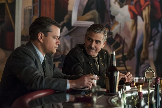 """This film image released by Columbia Pictures shows Matt Damon, left, and George Clooney in """"The Monuments Men."""" (AP Photo/Columbia Pictures - Sony, Claudette Barius)"""