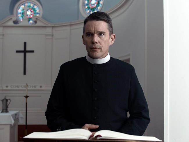 "This image released by A24 shows Ethan Hawke in a scene from ""First Reformed."" Paul Schrader's punishing drama about a protestant minister got a handful of Independent Spirit Award nominations, was selected by the National Board of Review and AFI as one of the top films of the year and won big at the Gotham Awards. But the film and Hawke failed to get any Golden Globe nominations. (A24 via AP)"