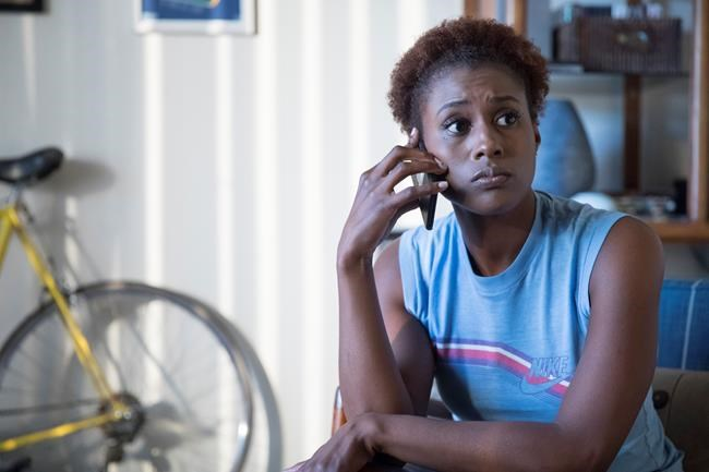 """This image released by HBO shows Issa Rae in a scene from """"Insecure."""" Rae was nominated Thursday for an Emmy for outstanding lead actress in a comedy series. The 70th Emmy Awards will be held on Monday, Sept. 17. (HBO via AP)"""