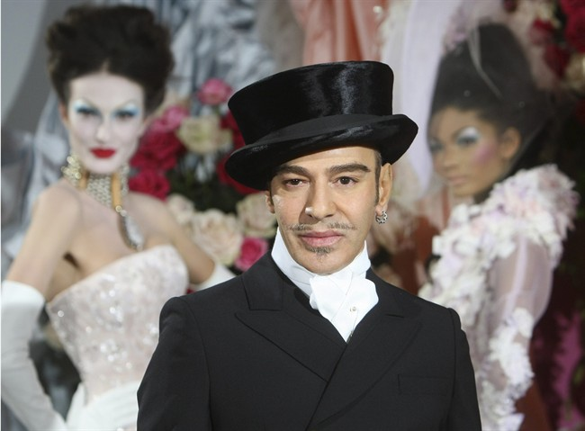 """Fashion designer John Galliano is planning to teach a master class some time this spring at Parsons The New School of Design in New York. The college said in a statement Monday, April 22, 2013, that the workshop will allow students to have a """"frank conversation"""" with Galliano. Galliano was the creative director at Christian Dior when he was fired in 2011 for making anti-Semitic comments, a crime in France. He is currently involved in a lawsuit against his former employer. (AP Photo/Jacques Brinon, file)"""