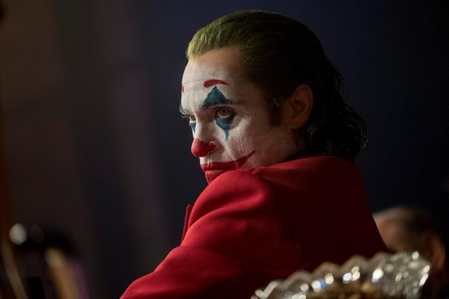 """This image released by Warner Bros. Pictures shows Joaquin Phoenix in a scene from """"Joker."""" On Monday, Dec. 9, 2019, Phoenix was nominated for a Golden Globe for best actor in a motion picture drama for his role in the film. (Niko Tavernise/Warner Bros. Pictures via AP)"""