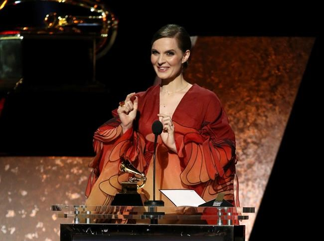 "Hildur Gudnadottir accepts the award for best score soundtrack for visual media for ""Chernobyl"" at the 62nd annual Grammy Awards on Sunday, Jan. 26, 2020, in Los Angeles. (Photo by Matt Sayles/Invision/AP)"