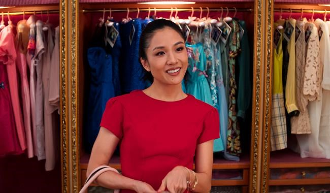 "This image released by Warner Bros. Entertainment shows Constance Wu in a scene from ""Crazy Rich Asians."" On Thursday, Dec. 6, 2018, Wu was nominated for a Golden Globe award for lead actress in a motion picture comedy or musical for her role in the film. The 76th Golden Globe Awards will be held on Sunday, Jan. 6. (Warner Bros. Entertainment via AP)"