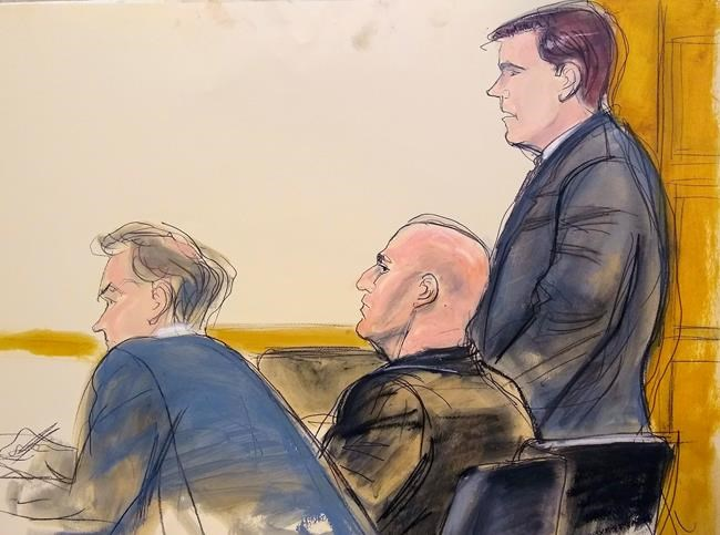 In this courtroom artist's sketch, defense attorney William Harrington, left, defendant David Correia, center, and defense attorney Jeff Marcus appear in Manhattan Federal Court Wednesday Oct. 16, 2019 in New York. Correia, 44, accused of conspiring with associates of Rudy Giuliani to make illegal campaign contributions, made a brief appearance before a federal judge in Manhattan, who ordered him released on a $250,000 bond. (AP Photo/Elizabeth Williams)