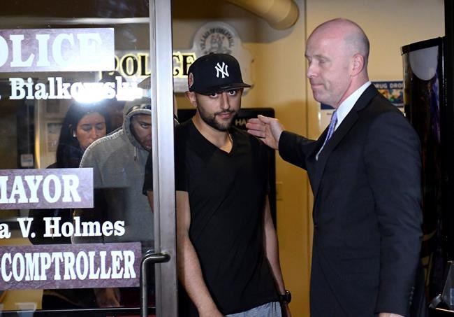 Nauman Hussain, left, leaves Cobleskill Town court with his attorney Lee Kindlon after arraignment Wednesday, Oct. 10, 2018. The limousine service operator, Hussain, was charged Wednesday with criminally negligent homicide in a crash that killed 20 people, while police continued investigating what caused the wreck and whether anyone else will face charges. (AP Photo/Hans Pennink)