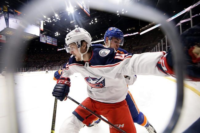 Columbus Blue Jackets' Dean Kukan, left, fights for position with New York Islanders' Michael Dal Colle during the second period of an NHL hockey game Monday, Dec. 23, 2019, in Uniondale, N.Y. (AP Photo/Frank Franklin II)