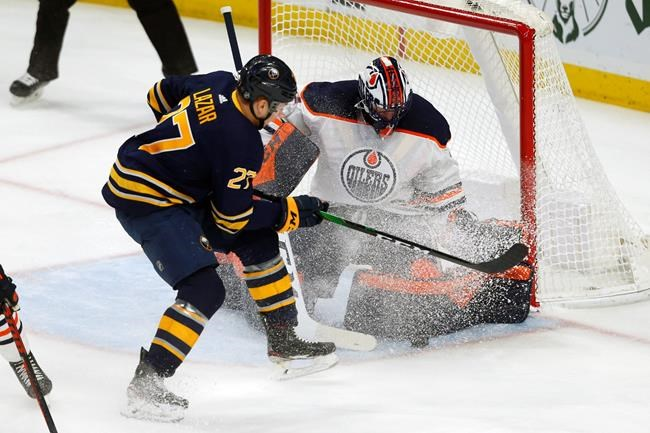 Buffalo Sabres forward Curtis Lazar (27) is stopped by Edmonton Oilers goalie Mike Smith (41) during the first period of an NHL hockey game Thursday, Jan. 2, 2020, in Buffalo, N.Y. (AP Photo/Jeffrey T. Barnes)