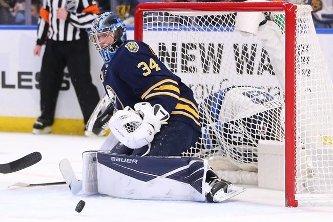 Buffalo Sabres goalie Jonas Johansson (34) makes a save during the second period of an NHL hockey game against the Winnipeg Jets, Sunday, Feb. 23, 2020, in Buffalo, N.Y. (AP Photo/Jeffrey T. Barnes)