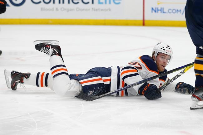 Edmonton Oilers forward Connor McDavid (97) is tripped during the second period of an NHL hockey game against the Buffalo Sabres, Thursday, Jan. 2, 2020, in Buffalo, N.Y. (AP Photo/Jeffrey T. Barnes)