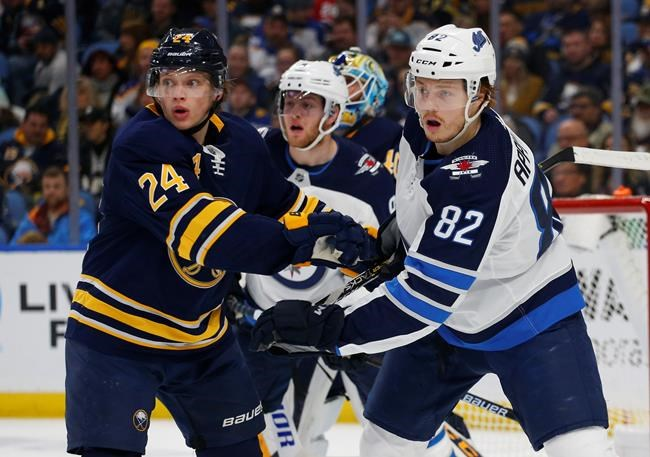 Buffalo Sabres defenseman Lawrence Pilut (24) and Winnipeg Jets forward Mason Appleton (82) battle for position during the second period of an NHL hockey game, Sunday, Feb. 10, 2019, in Buffalo N.Y. (AP Photo/Jeffrey T. Barnes)