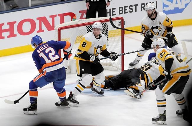 New York Islanders right wing Josh Bailey (12) prepares to take the game-wining shot during overtime of Game 1 of an NHL hockey first-round playoff series against the Pittsburgh Penguins, Wednesday, April 10, 2019, in Uniondale, N.Y. The Islanders won 4-3. (AP Photo/Julio Cortez)
